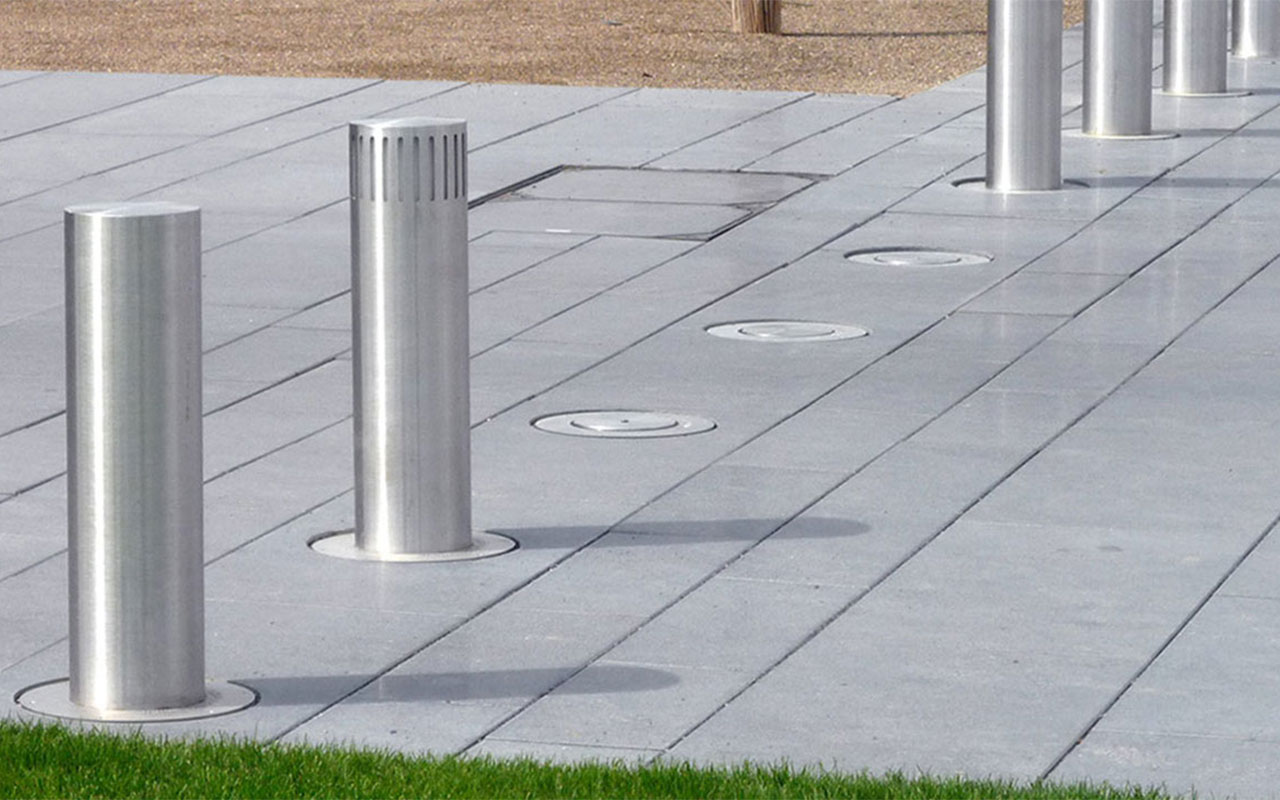Automatic bollard with lighting